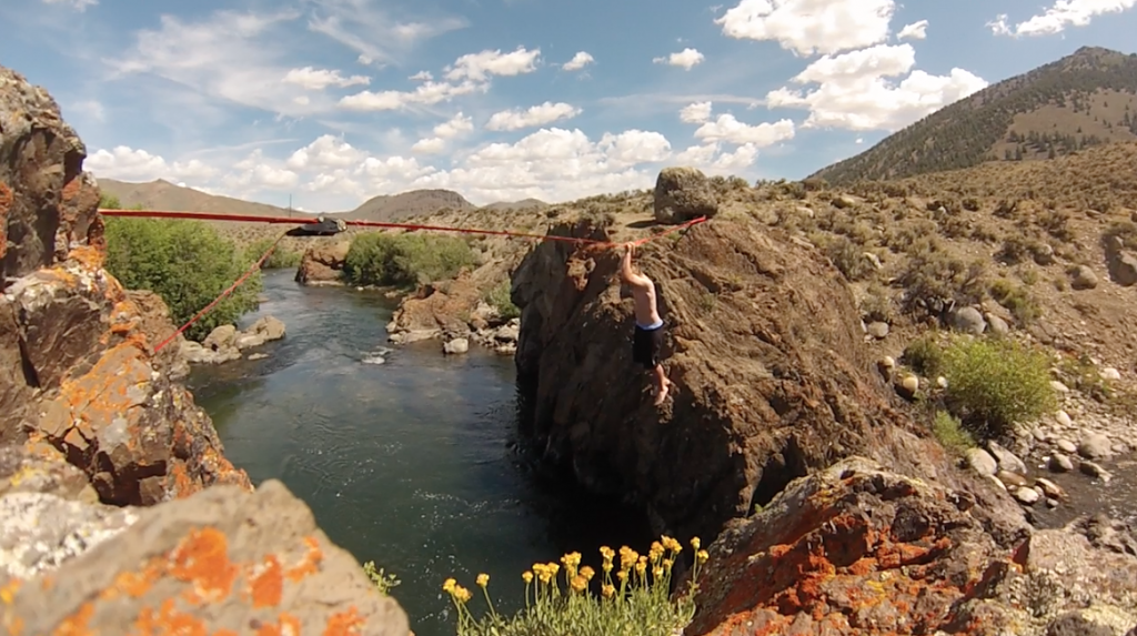 Testing out the slackline over the river at the Trail Creek destination